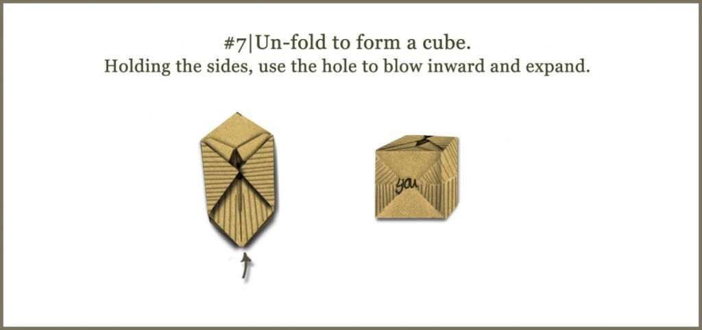 Un-fold to form a cube. Holding the sides, use the hole to blow inward and expand.
